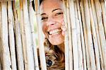 Close up of woman and dog behind fence Stock Photo - Premium Royalty-Freenull, Code: 649-05819718