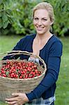Woman carrying basket of cherries Stock Photo - Premium Royalty-Free, Artist: Michael Mahovlich, Code: 649-05819813