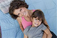 Mother and daughter relaxing on blanket Stock Photo - Premium Royalty-Freenull, Code: 649-05819853