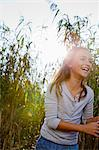 Smiling girl walking in wheatfield Stock Photo - Premium Royalty-Free, Artist: Raimund Linke, Code: 649-05819861