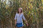 Smiling girl walking in wheatfield Stock Photo - Premium Royalty-Free, Artist: Jean-Christophe Riou, Code: 649-05819865