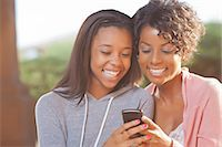 Mother and daughter using cell phone Stock Photo - Premium Royalty-Freenull, Code: 649-05819969