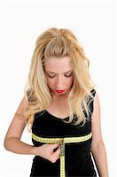 Woman measuring her bust Stock Photo - Premium Royalty-Freenull, Code: 649-05820628