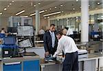 Security Guard Checking Businessman's Luggage in Airport Stock Photo - Premium Rights-Managed, Artist: Michael Mahovlich, Code: 700-05821740