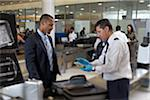 Security Guard Examining Contents of Businessman's Suitcase in Airport Stock Photo - Premium Rights-Managed, Artist: Michael Mahovlich, Code: 700-05821743