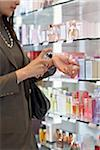 Businesswoman Shopping for Perfume in Duty-Free Shop Stock Photo - Premium Rights-Managed, Artist: Michael Mahovlich, Code: 700-05821750
