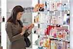 Businesswoman Shopping for Perfume at Duty-Free Shop Stock Photo - Premium Rights-Managed, Artist: Michael Mahovlich, Code: 700-05821751