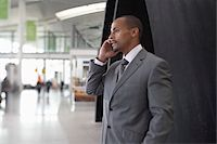 Businessman Using Cell Phone in Airport Stock Photo - Premium Rights-Managednull, Code: 700-05821753