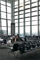 Business People in Waiting Area of Airport Stock Photo - Premium Rights-Managednull, Code: 700-05821762