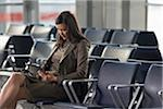 Businesswoman Using Tablet Computer in Airport Stock Photo - Premium Rights-Managed, Artist: Michael Mahovlich, Code: 700-05821766