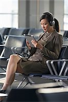 Businesswoman with Tablet PC in Airport Stock Photo - Premium Rights-Managednull, Code: 700-05821768