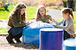 Sisters Drumming at Playground Stock Photo - Premium Rights-Managed, Artist: Jim Craigmyle, Code: 700-05821913