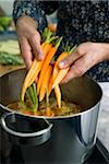 Adding the vegetables Stock Photo - Premium Rights-Managed, Artist: Photocuisine, Code: 825-05836840
