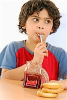 Boy eating jam Stock Photo - Premium Rights-Managednull, Code: 825-05837161