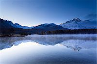 snow capped - Piz de la Margna Reflected in Lake Sils, Engadin, Switzerland Stock Photo - Premium Royalty-Freenull, Code: 600-05837587