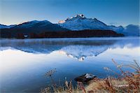 snow capped - Piz de la Margna reflected in Lake Sils, Engadin, Switzerland Stock Photo - Premium Royalty-Freenull, Code: 600-05837588