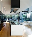 Interior of modern glass house. Open plan kitchen with island unit in UP House, Hertzelia, Tel Aviv, Israel. Architects: Pitsou Kedem Stock Photo - Premium Rights-Managed, Artist: Arcaid, Code: 845-05837771
