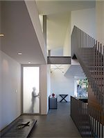 Silhouette of man at door of double height entrance hall, Briarcrest House, Beverly Hills, California, USA. Architects: SPF Architects Stock Photo - Premium Rights-Managednull, Code: 845-05837897