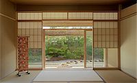 Traditionally Japanese sparsely furnished room with view through sliding doors to garden Stock Photo - Premium Rights-Managednull, Code: 845-05838903