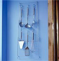 Stainless steel kitchen utensils on hanging wire rack Stock Photo - Premium Rights-Managednull, Code: 845-05838940