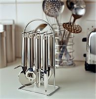 Stainless steel kitchen utensils on hanging stand Stock Photo - Premium Rights-Managednull, Code: 845-05838948