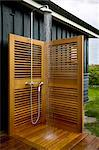 Water running from shower tap fitting in outdoor shower with wooden screens Stock Photo - Premium Rights-Managed, Artist: Arcaid, Code: 845-05838974