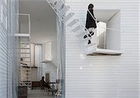 Yokohama Apartment, Apartment house, View of the staircase and opening at the western facade. Architects: Osamu Nishida + Erika Nakagawa, ON Design Stock Photo - Premium Rights-Managednull, Code: 845-05839529
