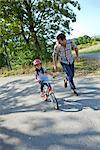 Father running next to daughter on bike Stock Photo - Premium Rights-Managed, Artist: F1Online, Code: 853-05840937