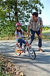 Father running next to daughter on bike Stock Photo - Premium Rights-Managed, Artist: F1Online, Code: 853-05840940