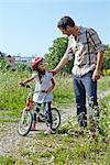 Father and daughter on bike outdoors Stock Photo - Premium Rights-Managed, Artist: F1Online, Code: 853-05840949