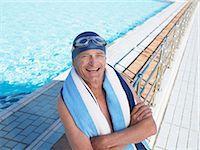 seniors and swim cap - Senior man standing by swimming pool arms folded, smiling, portrait Stock Photo - Premium Royalty-Freenull, Code: 6106-05843383