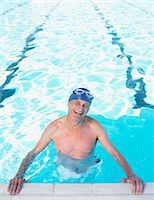 seniors and swim cap - Senior man wearing swimming hat standing in pool, smiling, portrait Stock Photo - Premium Royalty-Freenull, Code: 6106-05843385