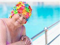 seniors and swim cap - Senior woman wearing swimming hat standing by pool, smiling, portrait Stock Photo - Premium Royalty-Freenull, Code: 6106-05843389