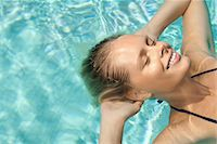 refraction - Woman floating in pool with eyes closed Stock Photo - Premium Royalty-Freenull, Code: 632-05845229