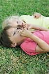 Young friends lying together on grass Stock Photo - Premium Royalty-Free, Artist: Kevin Dodge, Code: 632-05845319