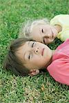 Boy and girl lying on grass, portrait Stock Photo - Premium Royalty-Free, Artist: Kevin Dodge, Code: 632-05845358
