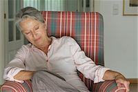Senior woman napping in armchair Stock Photo - Premium Royalty-Freenull, Code: 632-05845601