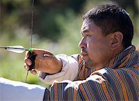 Local man taking part in archery competition using traditional bow, Jakar, Bumthang, Bhutan, Asia Stock Photo - Premium Rights-Managednull, Code: 841-05845870