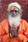 Sadhu (Holy Man) wearing brightly coloured clothing and characteristic facial painting at Pashupatinath Temple, Kathmandu, Nepal, Asia