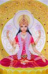 Picture of Lakshmi, goddess of wealth and consort of Lord Vishnu, sitting holding lotus flowers, Haridwar, Uttarakhand, India, Asia Stock Photo - Premium Rights-Managed, Artist: Robert Harding Images, Code: 841-05846907