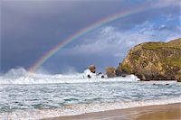 Sea stacks, rainbow, stormy clouds and rough seas on a windy afternoon at Dalmore Bay on the Isle of Lewis, Outer Hebrides, Scotland, United Kingdom, Europe Stock Photo - Premium Rights-Managednull, Code: 841-05848780