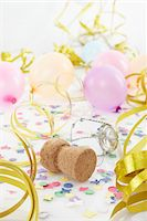 Champagne Cork, Balloons and Streamers Stock Photo - Premium Royalty-Freenull, Code: 600-05854213