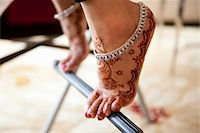 Close-Up of Bride on Tip-Toes Stock Photo - Premium Rights-Managednull, Code: 700-05855234