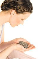 smelly - Portrait of a young woman holding grains of lavander Stock Photo - Premium Royalty-Freenull, Code: 6108-05855937