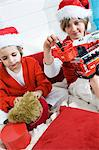 2 boys disguised as Santa Claus playing Stock Photo - Premium Royalty-Free, Artist: Robert Harding Images, Code: 6108-05856103