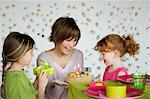 Woman and 2 little girls with birthday cake Stock Photo - Premium Royalty-Free, Artist: CulturaRM, Code: 6108-05856645