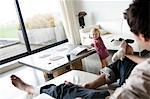 Man and little boy in a living-room Stock Photo - Premium Royalty-Free, Artist: CulturaRM, Code: 6108-05856825