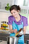 Young smiling woman cooking pasta Stock Photo - Premium Royalty-Free, Artist: Photocuisine, Code: 6108-05857011