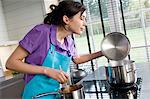 Young woman cooking Stock Photo - Premium Royalty-Free, Artist: Photocuisine, Code: 6108-05857021