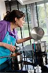 Young woman cooking Stock Photo - Premium Royalty-Freenull, Code: 6108-05857047